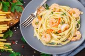 stock photo of shrimp  - Tagliatelle with shrimps and parsley on a plate - JPG