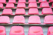 Red seats at soccer sports stadium