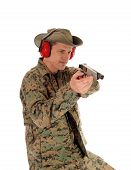image of pointed ears  - A closeup picture of a soldier in a camouflage uniform pointing a pistol