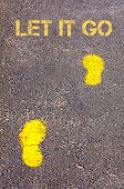 Yellow Footsteps On Sidewalk Towards Let It Go Message