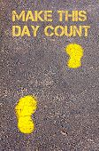 Yellow Footsteps On Sidewalk Towards Make This Day Count Message.