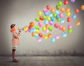 stock photo of circus clown  - Clown funny and creative screams colorful balloons - JPG