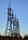 stock photo of transmission lines  - Electric transmission line tower against blue sky - JPG