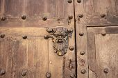 picture of hasp  - Old Man Face Shape Hasp in an old wooden door at Cartagena - JPG