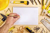 picture of carpentry  - Planning a Project in Carpentry and Woodwork Industry Notebook and Assorted Woodwork and Carpentry Tools on Pinewood Workshop Table - JPG