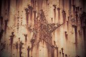 stock photo of iron star  - Rust star shpe on iron plate background texture - JPG