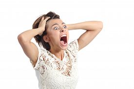 stock photo of horrifying  - Scared crazy woman crying with hands on head isolated on a white background - JPG