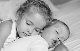 image of matron  - charming little brother and sister asleep embracing  - JPG
