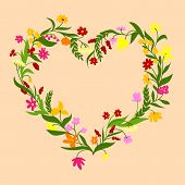 foto of pale  - Heart shaped floral border frame with delicate spring field flowers and sappy foliage of herbs on pale peach background for romantic design - JPG