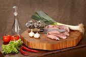 stock photo of pork chop  - sirloin pork and vegetables on a chopping board - JPG