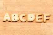 image of nouns  - Letter ABCDEF cookie over the wooden background - JPG