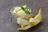 stock photo of banana split  - fruit ice cream with fresh banana and mint - JPG