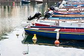 pic of dock a lake  - fishing boats moored in the dock of Lake Garda - JPG