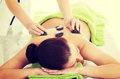 picture of stone-therapy  - Girl on a stone therapy - JPG