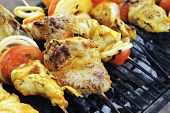 picture of charcoal  - fresh raw roast shish kebab on barbecue grill grid coocked over hot charcoal - JPG