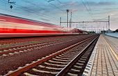 foto of high-speed train  - Speed Train in a station at twlight - JPG