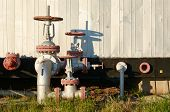 picture of pipeline  - Oil pipeline with a tap valve in the summer - JPG