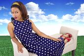 image of surrealism  - black female in a vintage polka dot dress in a surreal outdoors setting - JPG