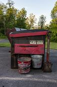 picture of dumpster  - A dumpster with buckets with disposing of campfire ashes - JPG