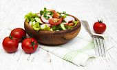 image of radish  - Spring salad with tomato cucumbers and radish on a wooden background - JPG