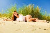 pic of dune grass  - Young woman female model in full length posing outdoor on background of dunes sky and grass - JPG