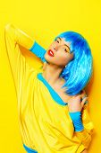 picture of wig  - Bright glamorous girl in vivid clothes and a wig alluring over yellow background - JPG