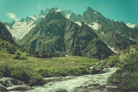 pic of mountain-range  - Mountain Valley a top view of the river bed. Landscape with a mountain river. Landscape with mountains trees and a river - JPG