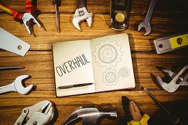 stock photo of overhauling  - The word overhaul and notebook and pen against blueprint - JPG
