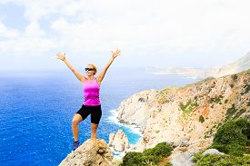 image of climb up  - Success achievement climbing or hiking accomplishment concept woman trail runner celebrating with arms up raised outstretched hiking climbing or cross country running healthy lifestyle - JPG