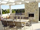 stock photo of pergola  - Ourdoor entertaining with fire seating for plenty of friends and with a nice garden setting - JPG