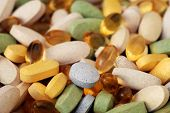 Macro image of various vitamins and nutritional supplements in natural sunlight with shallow dof.