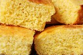 Freshly baked cornbread cut into squares.