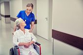 medicine, age, support, health care and people concept - happy nurse taking senior woman patient in  poster