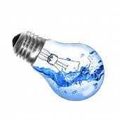 Energy concept. Light bulb with water and splash isolated on white