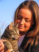 Brunette Girl Holding Her Cat