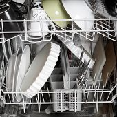 A dishwasher with lots of dishes and glasses