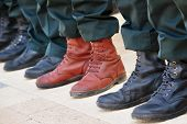 Постер, плакат: Army Boots Stand Out In A Crowd