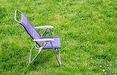 Canvas chair on a green grass