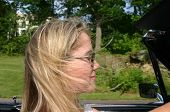 Profile Of Young Blonde Lady Driving Antique Convertible Car poster