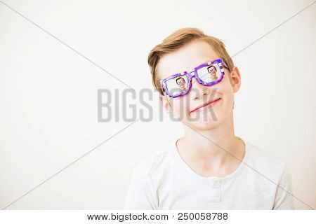 Young Boy With Glasses In
