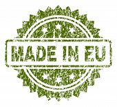 Made In Eu Stamp Seal Watermark With Scratched Style. Green Vector Rubber Print Of Made In Eu Text W poster