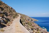 The footpath from Livadia to Lethra beach on the Greek island of Tilos. poster