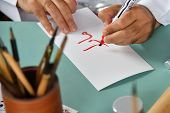 Hands Of A Man Writing Red Arabic Letters On A White Sheet Of Paper. Decorative Handwriting Or Handw poster
