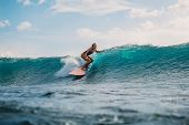 Surf Girl On Surfboard. Woman In Ocean During Surfing. Surfer And Ocean poster