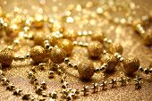 stock photo of gold glitter  - Christmas glittering golden beads and star string ornaments - JPG