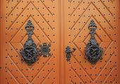 Old Wooden Doors With Beautiful Metal Forging. Vintage, Ornamental Wooden Door Background. Beautiful poster
