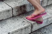 Closeup Of Female Legs In Pink Sandals Climbing The Stairs poster