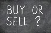 Buy or sell question on blackboard. Buying or selling question mark. Finance, economy, stock or real