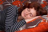 Girl Sleeping On Orange Sofa