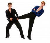 Ballroom Male Dancer Holding Leg Of His Funny Posing Friend